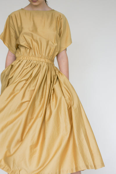 Black Crane Pleated Dress in Tan waist detail view