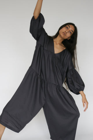 Black Crane Puff Jumpsuit in Faded Black on model view front