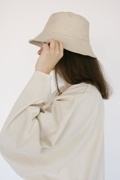 Clyde Lambskin Ebi Bucket Hat in Bone on model view side
