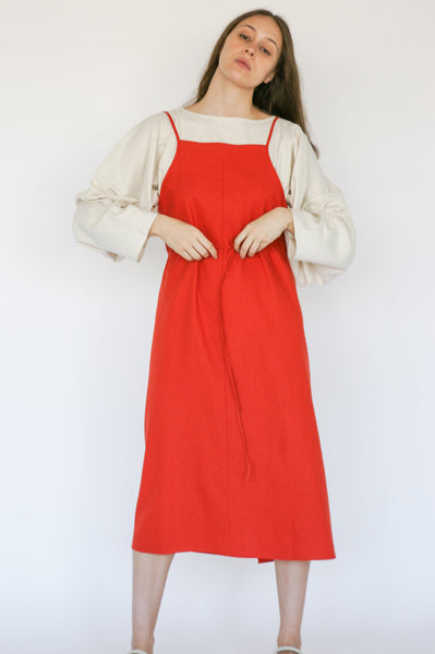 Baserange Yumi Apron Dress Linen/Cotton in Fire Red on model view front