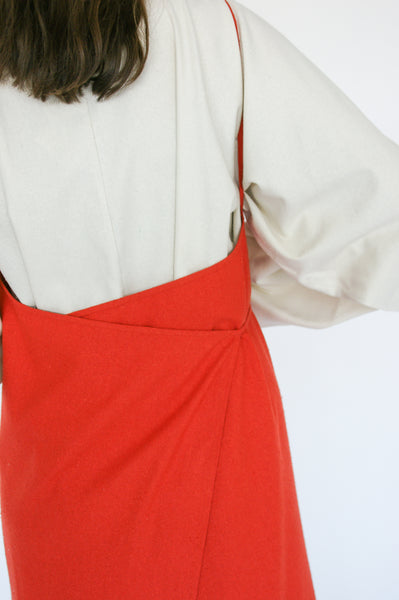 Baserange Yumi Apron Dress Linen/Cotton in Fire Red on model view back wrap detail view