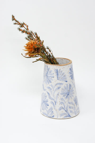 Michelle Blade Medium Cone Vase in Speckled White & Blue side view with flowers