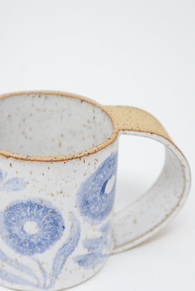 Michelle Blade Tall Gardener's Mug in Speckled White & Blue handle and rim diagonal top view