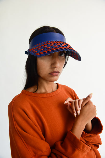 Hatori Leather Visor in Cobalto x Rust Orange on model view front