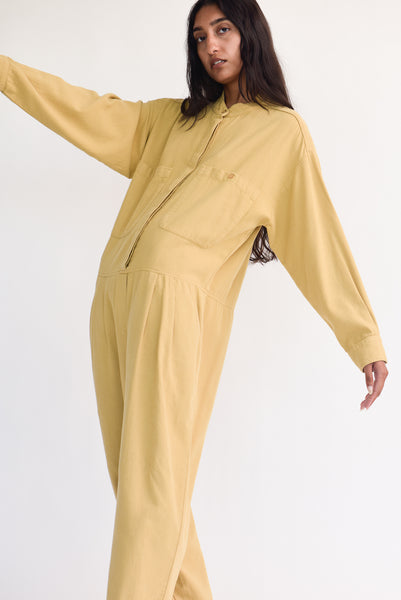 Black Crane Carpenter Jumpsuit in Tan on model view side