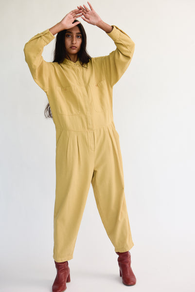 Black Crane Carpenter Jumpsuit in Tan on model view front