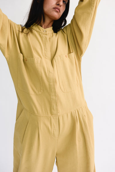 Black Crane Carpenter Jumpsuit in Tan pocket detail view