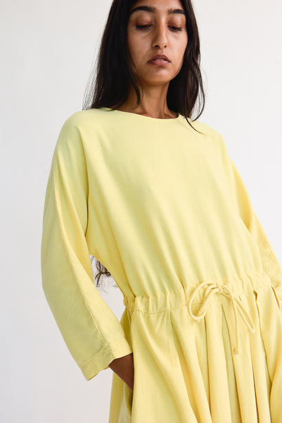 Black Crane Pleated Dress in Custard drawstring waist detail view