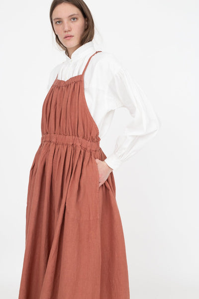 nest Robe Natural Dyed Linen Gathered Apron Dress in Brick | Oroboro Store | New York, NY