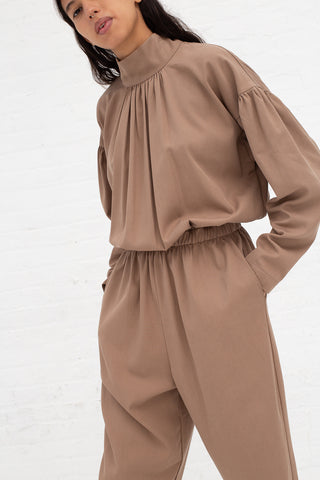 Black Crane Tulip Jumpsuit in Camel Tencel/Cotton, Front View Cropped Hands in Pocket
