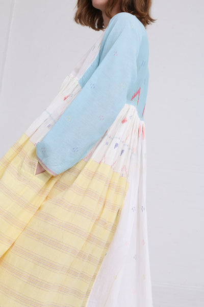 Injiri Dress in Blue / Pink / Yellow on model view pocket