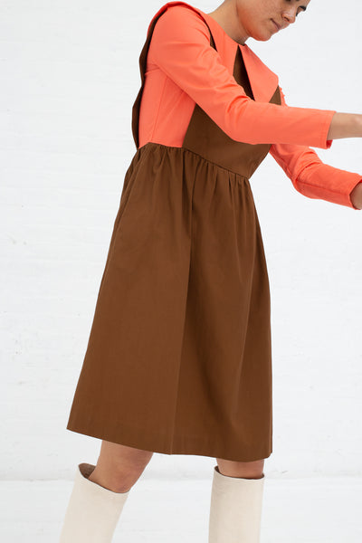 Batsheva Renaissance Dress in Coral and Brown, Side View Hands Out