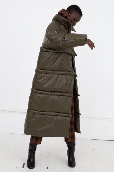 AVN Puffer Coat in Military Green Side View Arm in Air