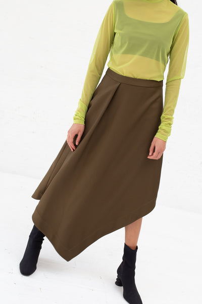 Nomia A-Line Asymmetric Skirt in Moss, Front View Cropped at Shoulders