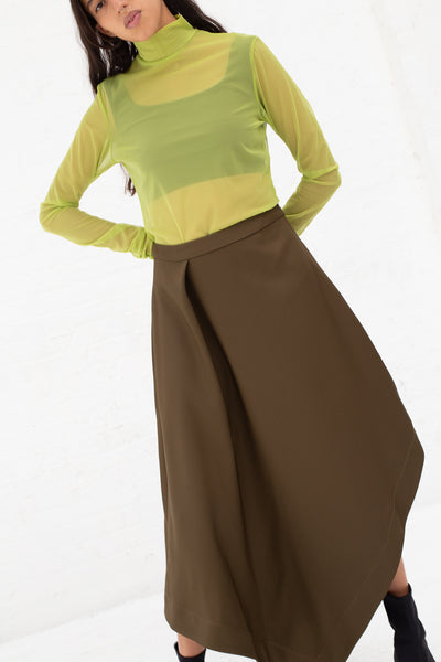 Nomia A-Line Asymmetric Skirt in Moss, Front View Cropped at Ankle
