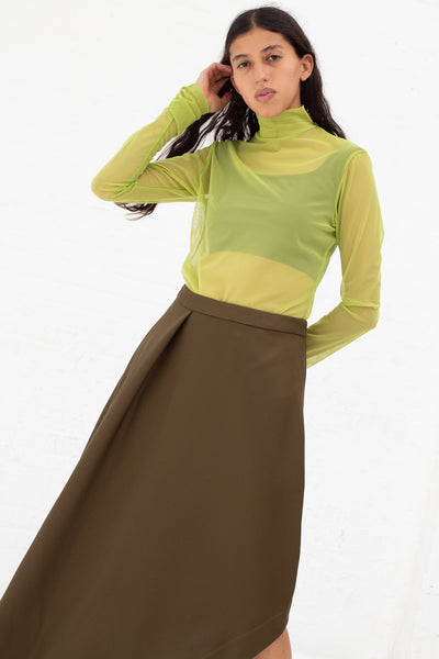 Nomia A-Line Asymmetric Skirt in Moss, Front View Cropped at Knee