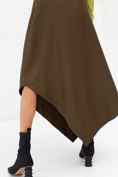 Nomia A-Line Asymmetric Skirt in Moss, Back View Close Up of Hem