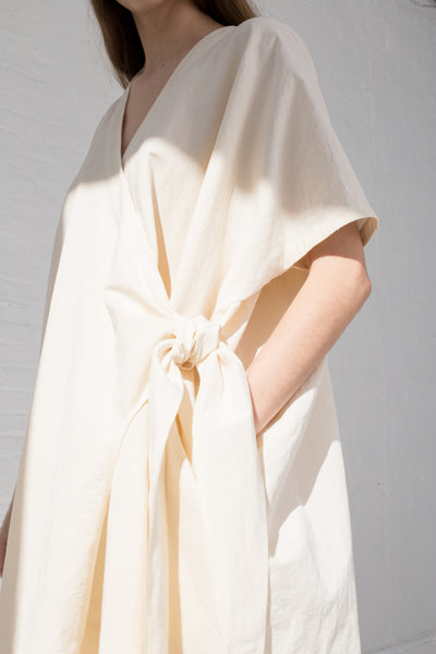 Lauren Manoogian Wrap Caftan in Raw White pocket detail view