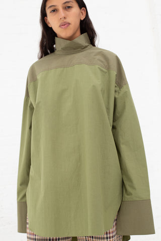 Nomia Oversize Mockneck Shirt in Bottle Green and Khaki, Front View Cropped Below Waist, Oroboro Store, New York, NY
