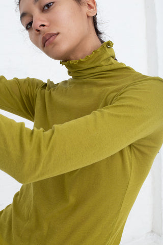 Baserange Puig Turtleneck in Olive cropped detail view