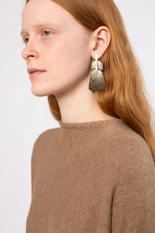 Erin Considine Splice Earrings in Hand Forged Oxidized Brass and Sterling Silver | Oroboro Store | New York, NY