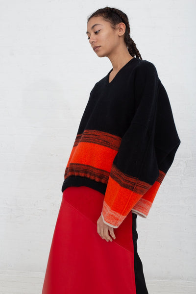 Vesture Felted Knit Oversize Wool Jumper in Black/Orange side view