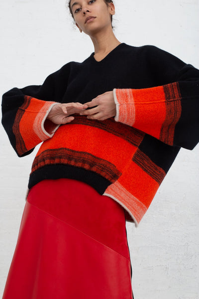 Vesture Felted Knit Oversize Wool Jumper in Black/Orange cropped front view