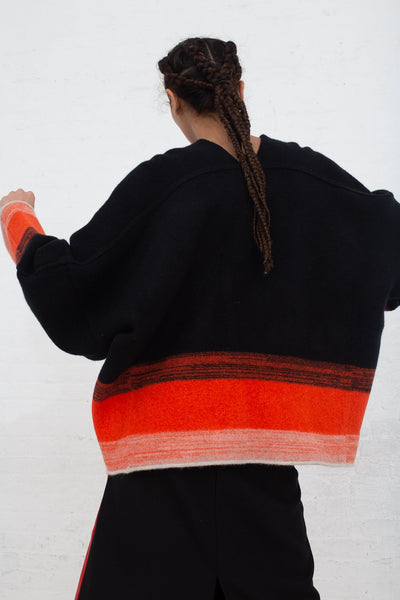 Vesture Felted Knit Oversize Wool Jumper in Black/Orange back view
