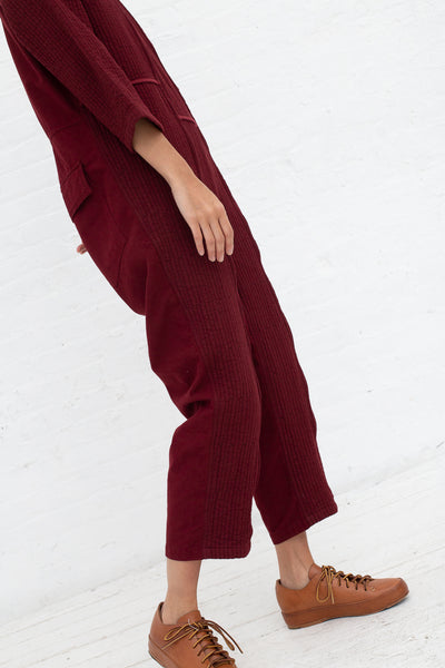 Caron Callahan Ace Jumpsuit in Burgundy, Side View Cropped at Shoulder