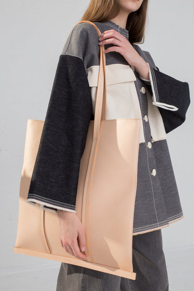 Building Block Large Line Tote in Veg Tan Leather on model view