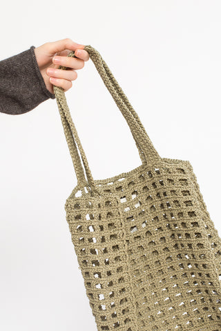 Lauren Manoogian Paper Net Bag in Herb, Hand Holding Bag Out, Cropped