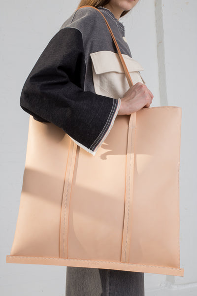 Building Block Large Line Tote in Veg Tan Leather on model view side