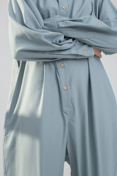 Baserange Marmo Jumpsuit in Buja Blue on model view sleeve