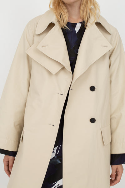 Studio Nicholson Angstrom Raincoat in Cream, Front View Cropped at Shoulder