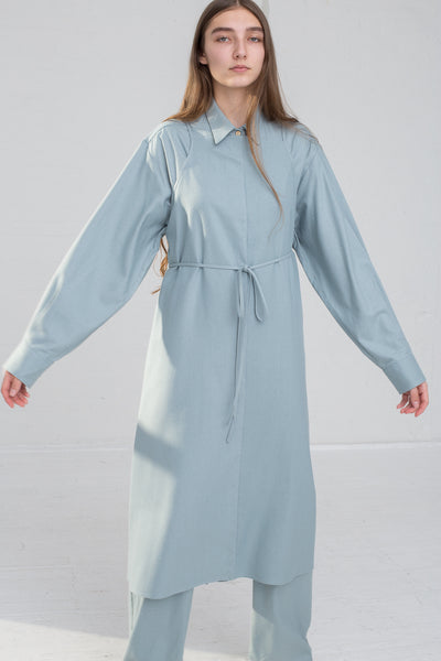 Baserange Yumi Apron Dress in Buja Blue on model view front