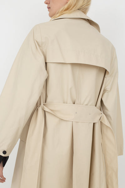 Studio Nicholson Angstrom Raincoat in Cream, Back View Cropped at Shoulder