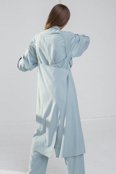 Baserange Yumi Apron Dress in Buja Blue on model view back