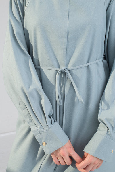 Baserange Yumi Apron Dress in Buja Blue on model view sleeve
