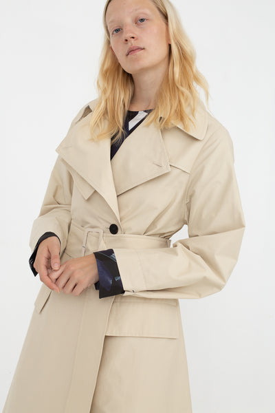 Studio Nicholson Angstrom Raincoat in Cream, Front View Cropped Above Knee