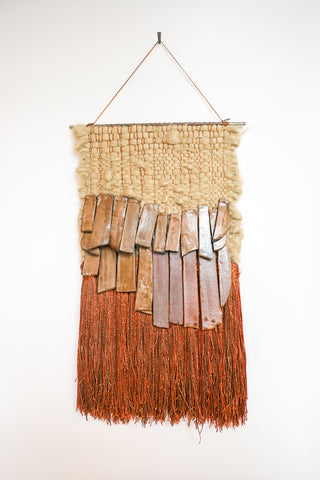 All Roads Woven Wall Hanging in Jute with Brown Ceramic and Red-Brown Fringe | Oroboro Store | New York, NY