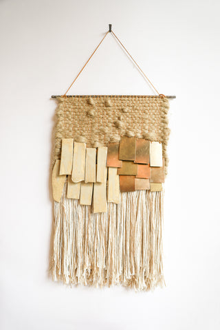 All Roads Woven Wall Hanging in Jute with Cream Ceramic and Brass and White Fringe | Oroboro Store | New York, NY