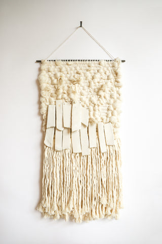 All Roads Woven Wall Hanging in Jute with White Ceramic and White Fringe | Oroboro Store | New York, NY