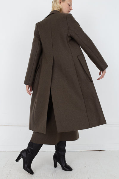Studio Nicholson Ounce Coat in Forest Green, Back View