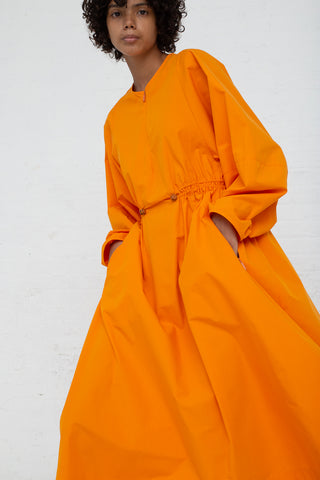 Studio Nicholson Sporty Volume Dress in Saffron cropped front view