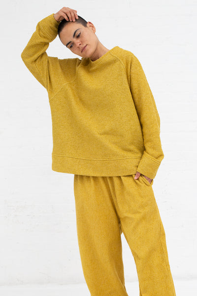 Marrakshi Life Boucle Palazzo Pants in Boucle Curry, Front View Hand on Head