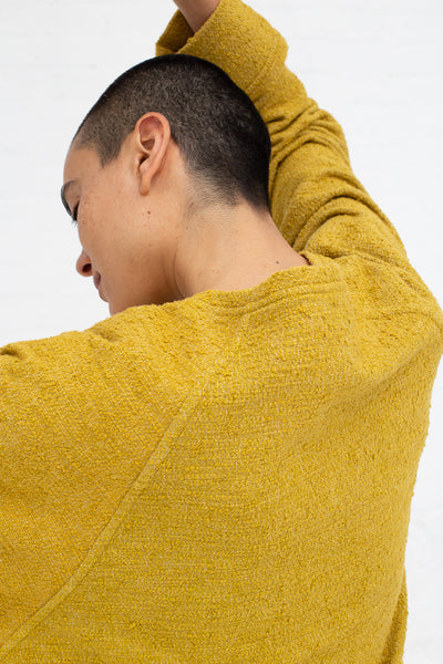 Marrakshi Life Sweatshirt in Boucle Curry, Back View Arm Above Head