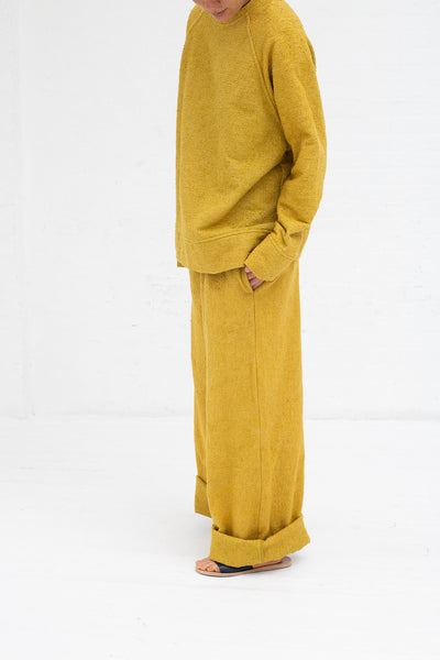 Marrakshi Life Boucle Palazzo Pants in Boucle Curry, Side View Hand in Pocket