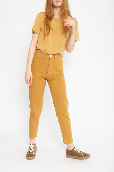 Jesse Kamm Ranger Pant in Wheat, Front View Hand in Hair