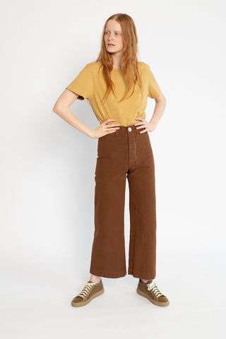 Jesse Kamm Sailor Pant in Skintone 34, Front View Hands on Waist, Oroboro Store, New York, NY