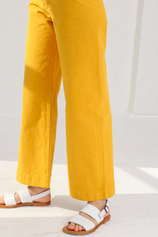 Jesse Kamm Sailor Pant in Caribbean Gold on model view leg